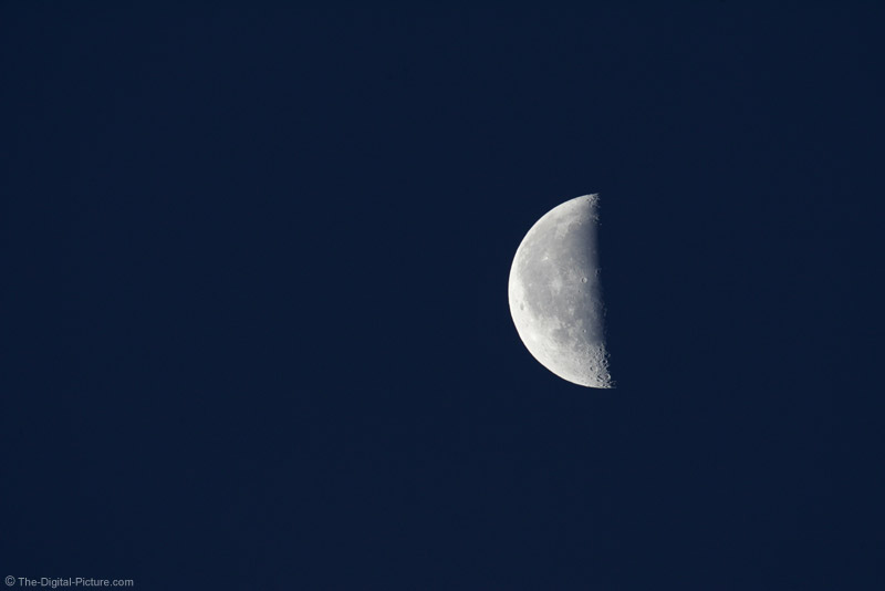 Half Moon Against Dark Blue Sky Picture