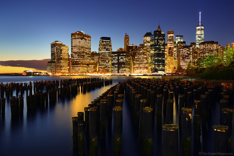Pilings brooklyn bridge park nyc skyline during blue hour for Best places to go in nyc at night